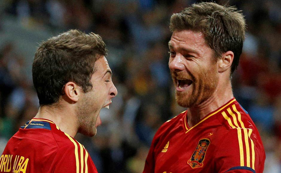 Spain's Jordi Alba, left, celebrates with his teammate Xabi Alonso after scoring his side's second goal. AP