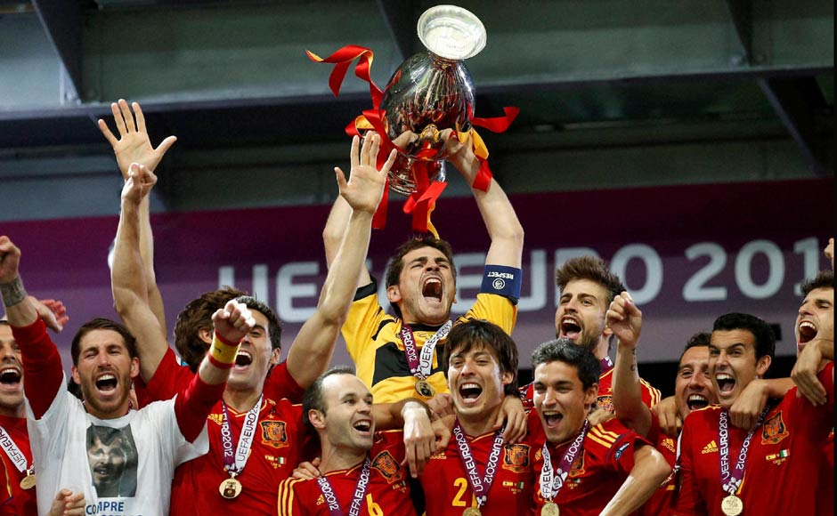 Spanish goalkeeper Iker Casillas lifts the Euro trophy. AP