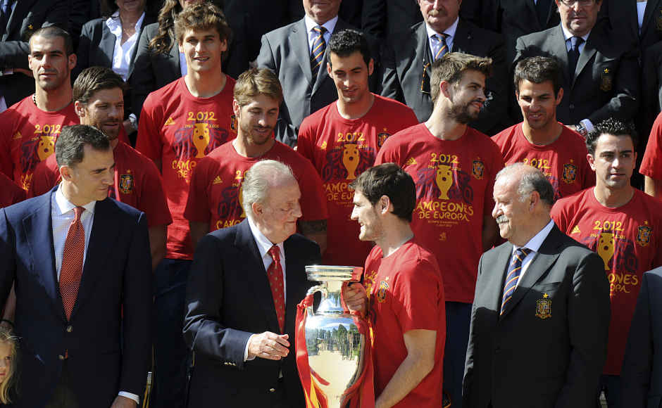 Casillas gives the Euro 2012 trophy to Spain's King Juan Carlos at the Euro 2012 at the Zarzuela Palace in Madrid. Reuters