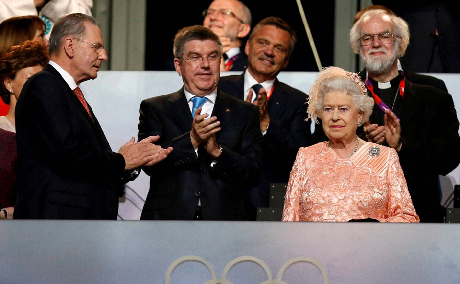 The President of the International Olympic Committee Jacques Rogge, left, and Britain's Queen Elizabeth II, foreground right, arrives during the Opening Ceremony at the 2012 Summer Olympics. AP/PTI