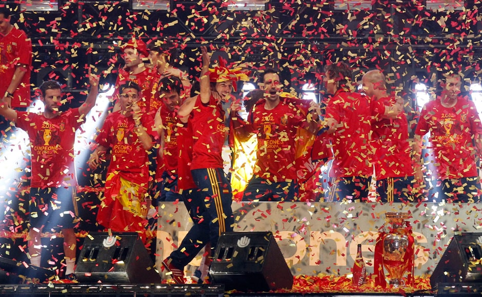 Spanish players seen in a sea of confetti as celebrations reached fever pitch. Reuters