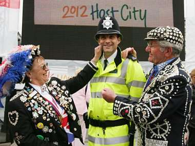 A traditional London Pearly King and Queen celebrate in London's Trafalgar Square after the announcement that London will host the 2012 Olympics. Reuters