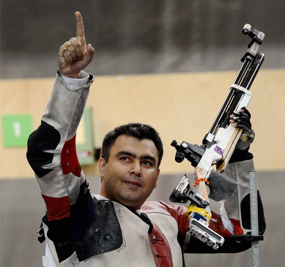 Gagan Narang reacts after winning bronze in 10m air rifle event at the Olympic Games 2012. PTI