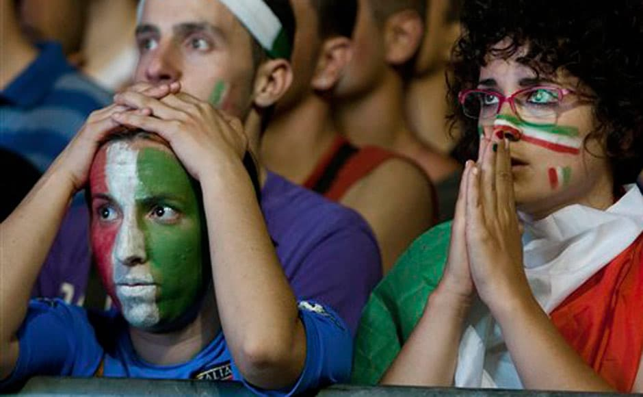 Italian supporters react during the Euro 2012 final. AP