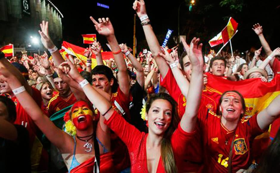 Spanish fans celebrate after their team defeated Italy in the Euro 2012 final. AP