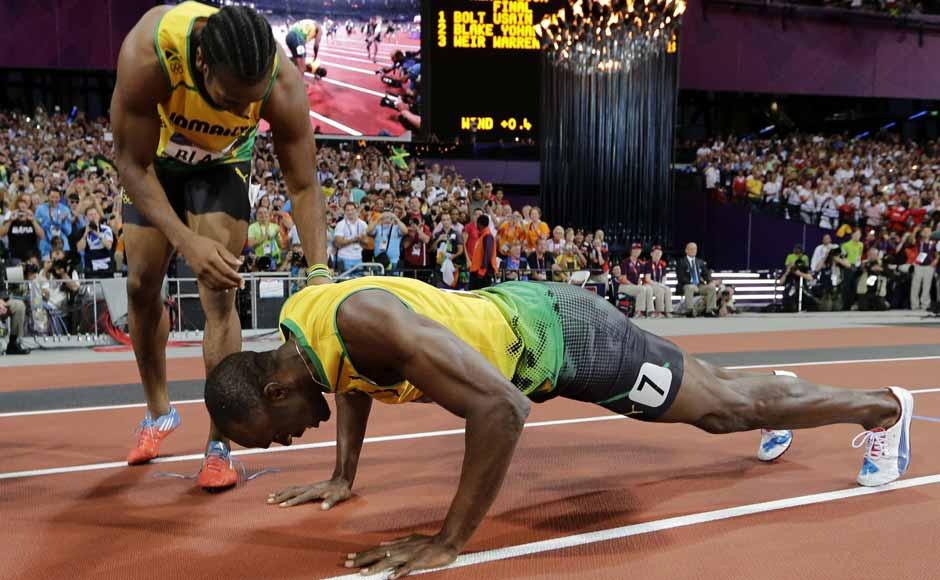 Jamaica's Yohan Blake, left, celebrates winning silver with Jamaica's Usain Bolt, who won gold, following the men's 200-meter final during the athletics. AP