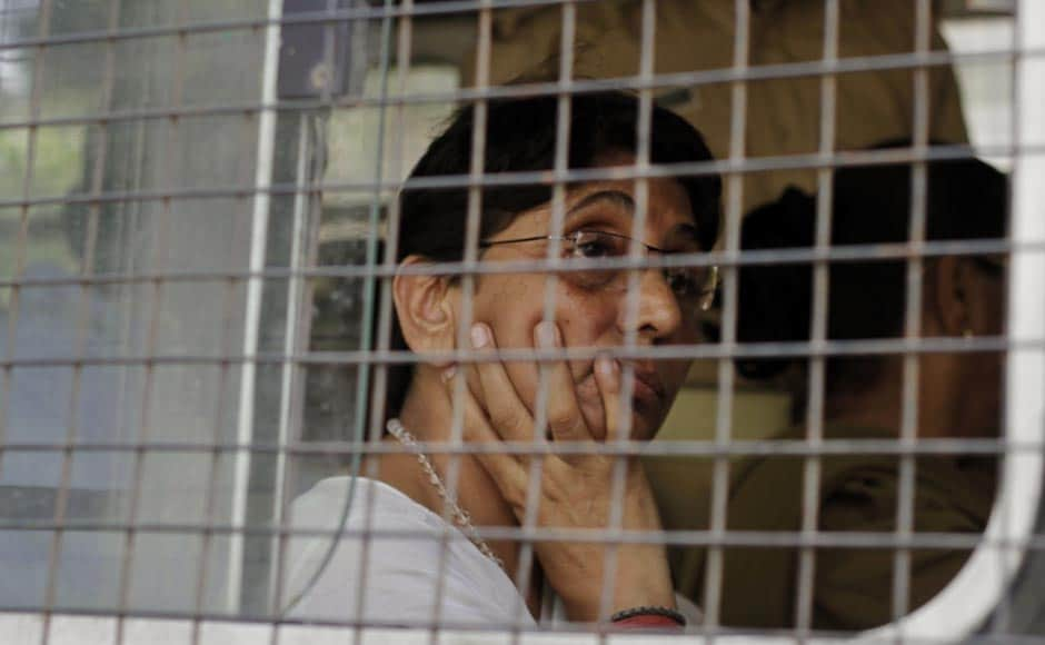 Maya Kodnani, in a police vehicle, arrives at a special court in Ahmedabad, ahead of the sentencing for the 2002 Naroda Patiya massacre. AP