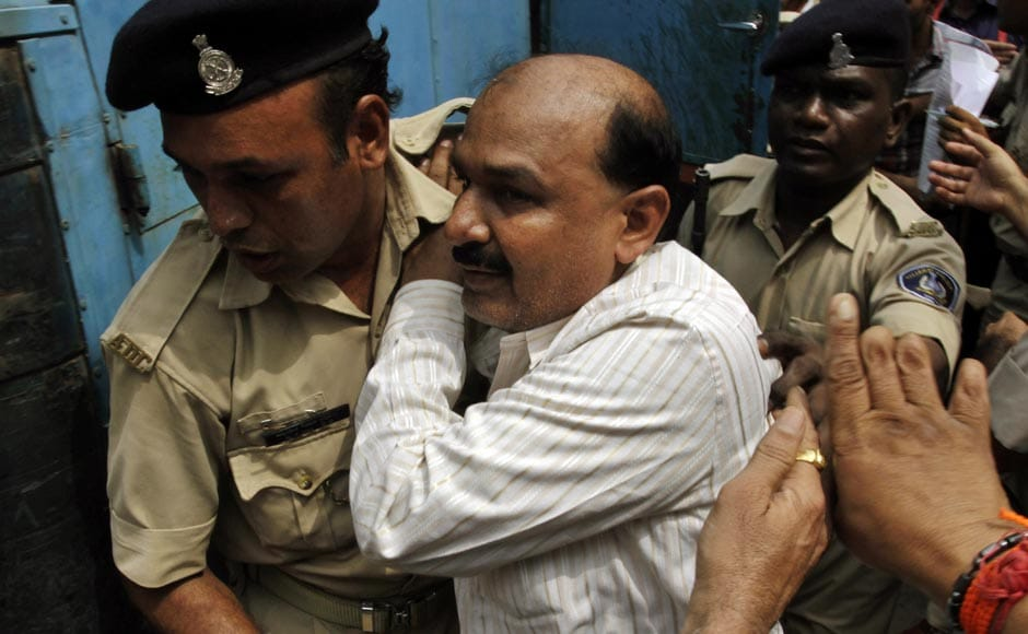 Former Bajrang Dal leader Babu Bajrangi, center, is escorted by policemen on his arrival at a special court in Ahmedabad, ahead of the sentencing for 2002 Naroda Patiya massacre . AP
