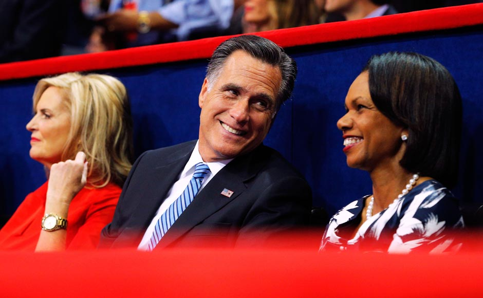 Republican presidential nominee Mitt Romney smiles as he talks with fomer US Secretary of State Condoleezza Rice (R) as they listen with his wife Ann Romney.Brian Snyder/Reuters