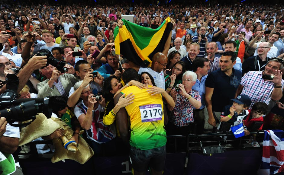 Usain Bolt of Jamaica celebrates with the crowd after winning gold in the Men's 200m Final.Stu Forster/Getty Images