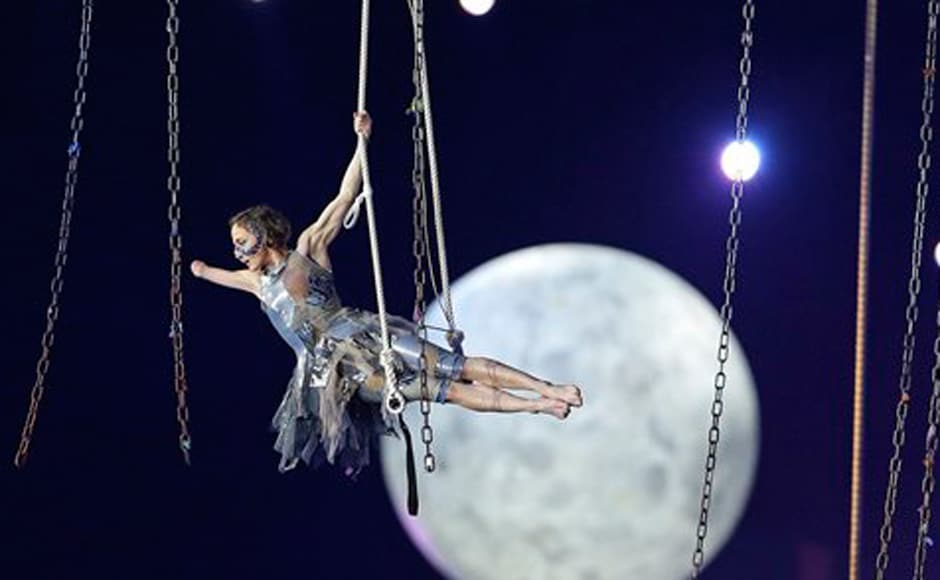 A performer is suspended in midair during the Paralympics Opening Ceremony. AP