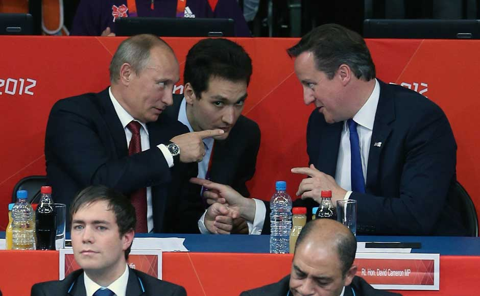 Russian President Vladimir Putin (L) watches Judo with British Prime Minister David Cameron at the London 2012 Olympic Games. Jeff J Mitchell/Getty Images
