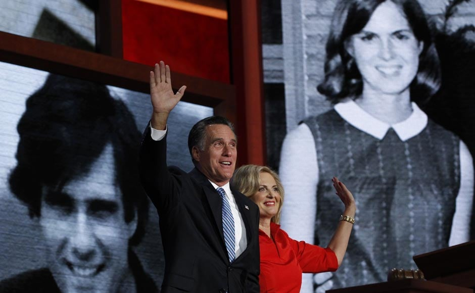 Ann Romney and her husband, Republican presidential candidate Mitt Romney, wave in front of family pictures shown on large screens after she addressed delegates during the second session of the Republican National Convention.Shannon Stapleton /Reuters