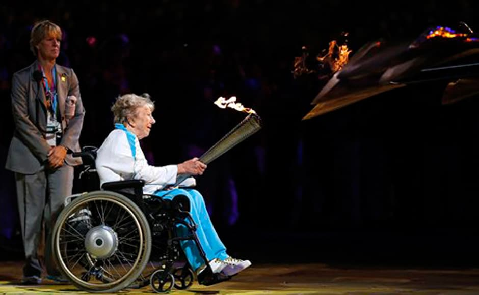 Margaret Maughan, Britain's first Paralympic gold medalist, lights the Paralympic flame. AP