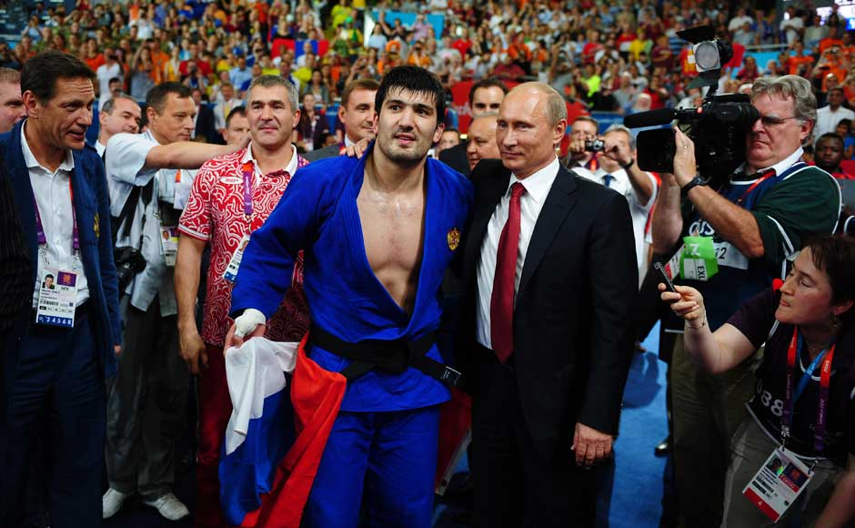 Russian President Vladimir Putin (C) congratulates Tagir Khaibulaev of Russia's after he won the gold medal in the Men's -100 kg Judo at the London Olympics. Laurence Griffiths/Getty Images
