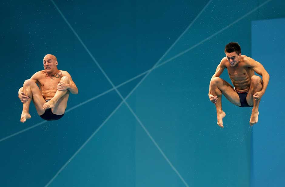 Spinning in mid-air: Maybe even you would look like this while somersaulting in mid-air. Nicholas Robinson-Baker and Chris Mears of Great Britain compete in the Men's Synchronised 3m Springboard final. Getty Images