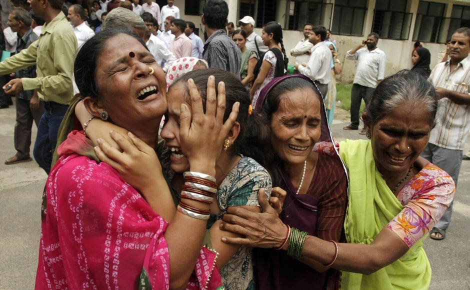 Relatives of an accused cry after hearing the court verdict on 29 August.AP