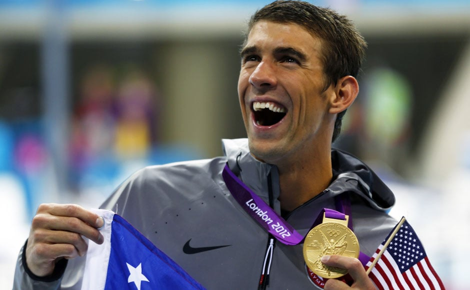 Michael Phelps holds his 19th Olympic medal presented to him in the men's 4x200m freestyle relay victory ceremony.Michael Dalder/Reuters
