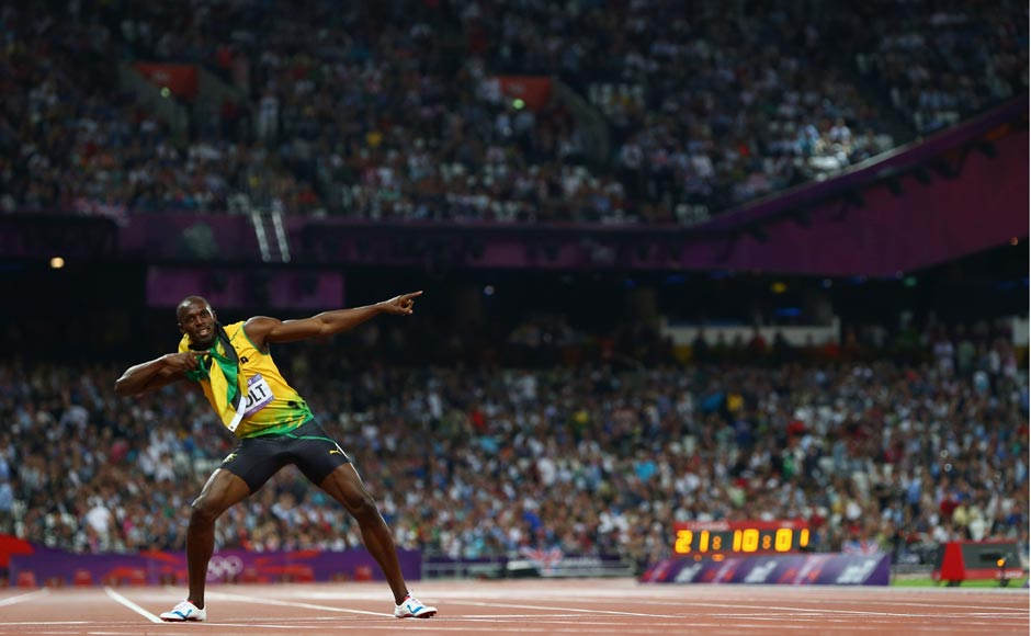 Usain Bolt of Jamaica celebrates after winning gold in the Men's 200m Final. Michael Steele/Getty Images