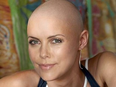 Charlize Theron not comfortable with her bald look