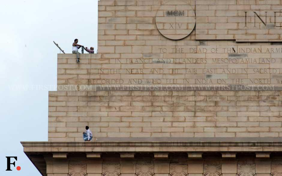 Workers ready the lighting atop India Gate. Naresh Sharma/ Firstpost