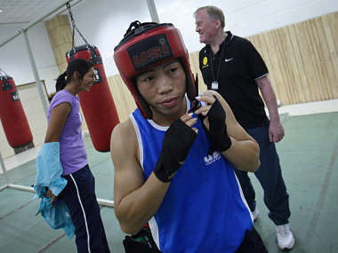India's boxer MC Mary Kom wears her head protection gear during a training session at Balewadi Stadium in Pune. Reuters