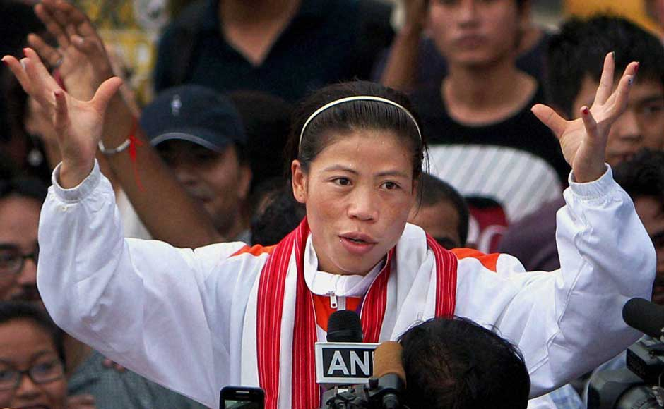 The usually shy Mary Kom had no option but to give in to media requests on her arrival. PTI