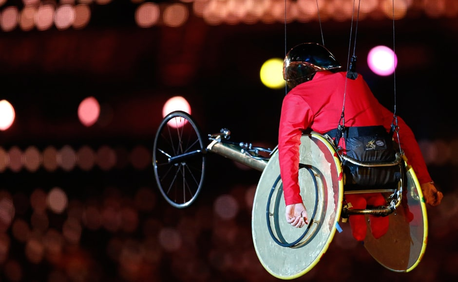 Former Paralympic athlete, Grey-Thompson, is lifted into air in Olympic Stadium during opening ceremony of London 2012 Paralympic Games. Reuters