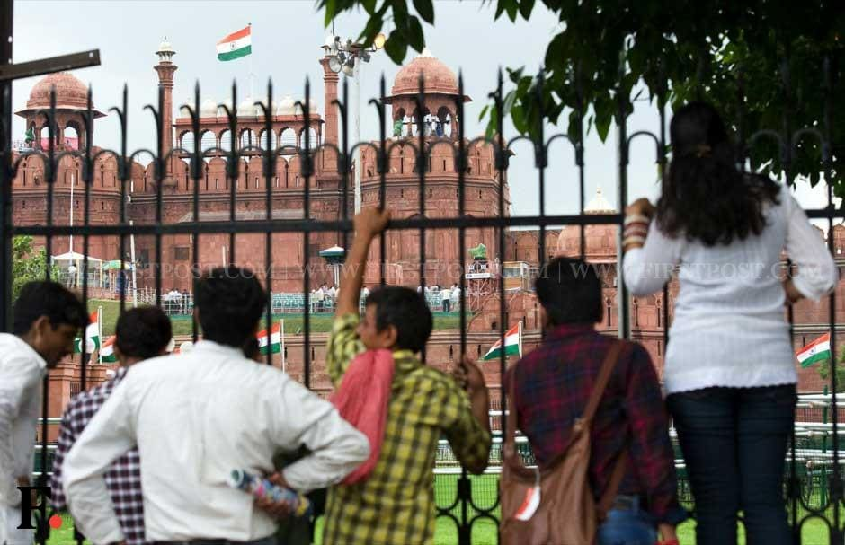 Tourists gaze at the Red Fort which has been readied for the Independence Day function. Naresh Sharma/Firstpost