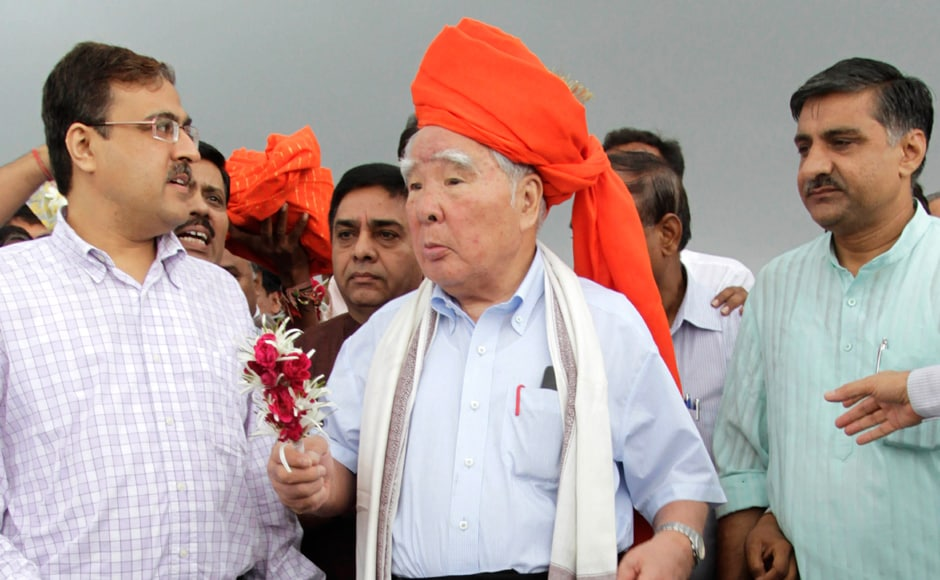 Suzuki Motor Corp. Chairman and Chief Executive Osamu Suzuki, center, receives a traditional welcome during his visit to the proposed site for Maruti Suzuki India Ltd's (MSIL) manufacturing facility at Hansalpur near Mehsana. AP