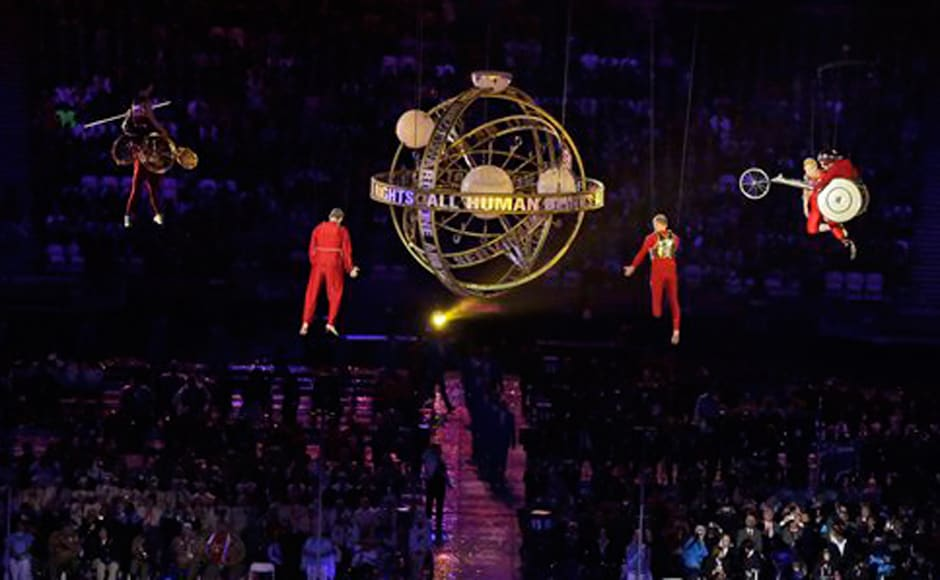 Performers race suspended in mid-air during the Opening Ceremony. AP