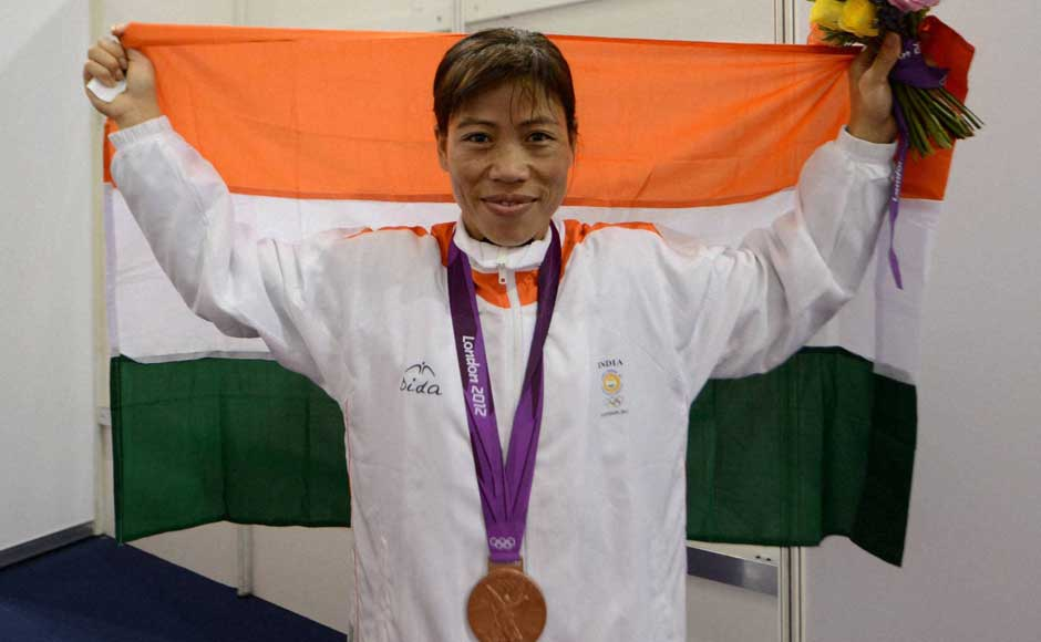 A proud Mary Kom poses with the Indian flag and her bronze medal. PTI