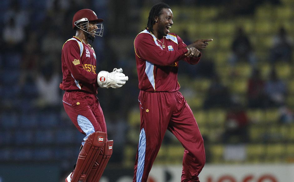 West Indies bowler Chris Gayle dances after taking the wicket of England's Jonny Bairstow, not seen, during the ICC Twenty20 Cricket World Cup Super Eight match in Pallekele, Sri Lanka.Aijaz Rahi/AP