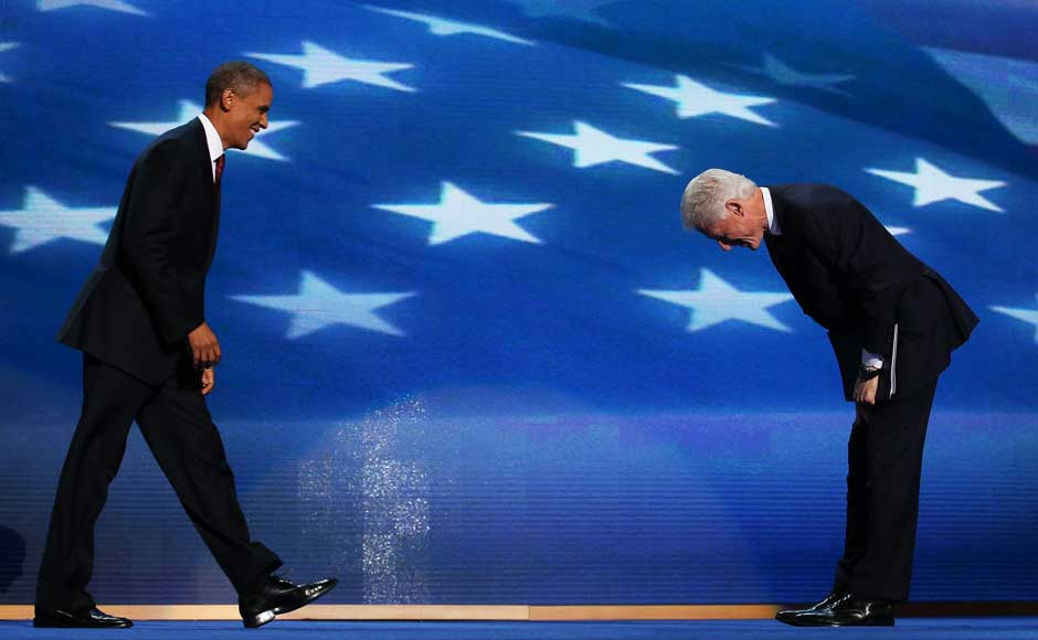 Former US President Bill Clinton greets Democratic presidential candidate, US President Barack Obama (L) on stage during day two of the Democratic National Convention. Chip Somodevilla/Getty Images.