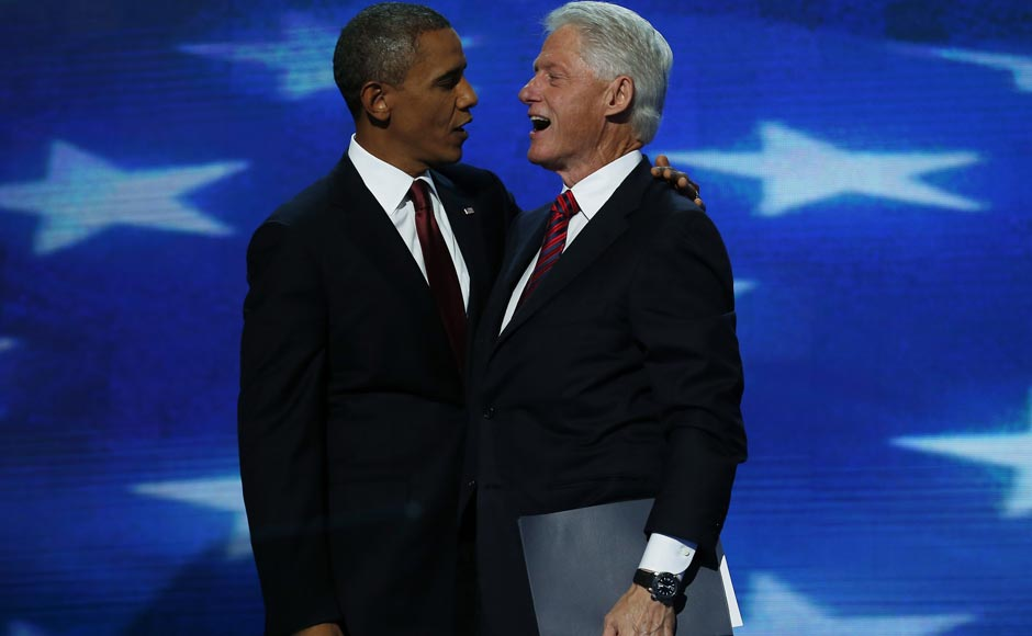 US President Barack Obama (L) embraces former President Bill Clinton after Clinton addressed the second session of the Democratic National Convention. Jim Young/Reuters