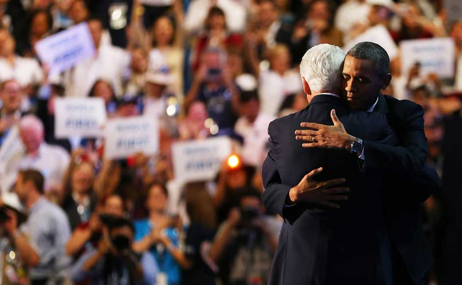 Bill Clinton hugs Democratic presidential candidate, US President Barack Obama (R) on stage during day two of the Democratic National Convention. Joe Raedle/Getty Images