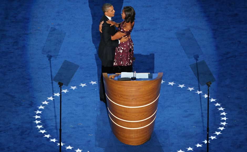 Democratic presidential candidate, US President Barack Obama hugs First lady Michelle Obama on stage during the final day of the Democratic National Convention. Streeter Lecka/Getty Images