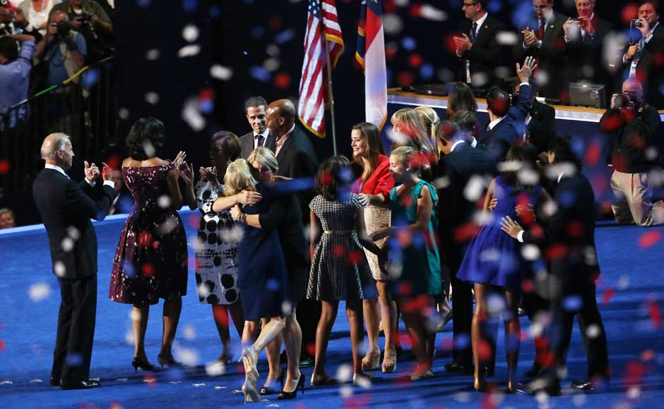 Democratic presidential candidate, US President Barack Obama and Democratic vice presidential candidate, US Vice President Joe Biden greet their families on stage after accepting the nomination during the final day of the Democratic National Convention. Streeter Lecka/Getty Images