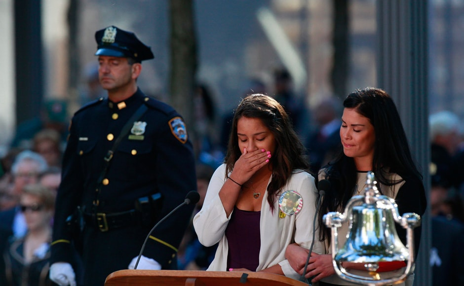 A reader weeps while reading victims' names during ceremonies marking the 11th anniversary of the September 11 attacks on the World Trade Center, in New York. Reuters