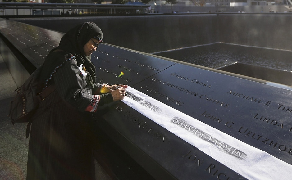 Khudeza Begum etches the name of her nephew during ceremonies marking the 11th anniversary of the 9/11 attacks on the World Trade Center in New York. Reuters