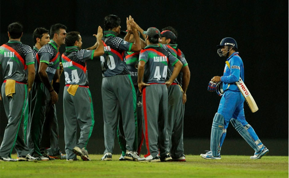 Afghanistan team mates celebrate the wicket of Virender Sehwag, right, during their ICC Twenty20 Cricket World Cup match on Wednesday. AP