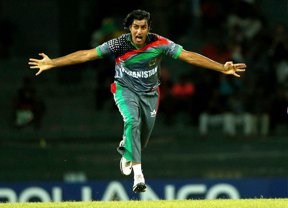 Afghanistan's bowler Shapoor Zadran celebrates after taking the wicket of Gautam Gambhir, unseen, during their ICC Twenty20 Cricket World Cup match on Wednesday. AP
