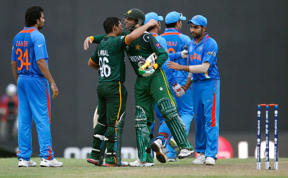 Pakistan's batsman Kamran Akmal hugs teammate Shoaib Malik after their win in a warm-up match against India ahead of the World T20. Akmal played a gem of an innings. AP