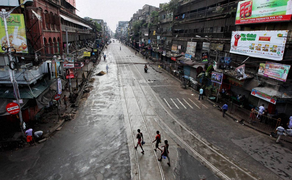 "A view of a deserted street during opposition-sponsored ""Bharat bandh"" called to protest against FDI in retail and price hike of diesel in Kolkata. PTI"
