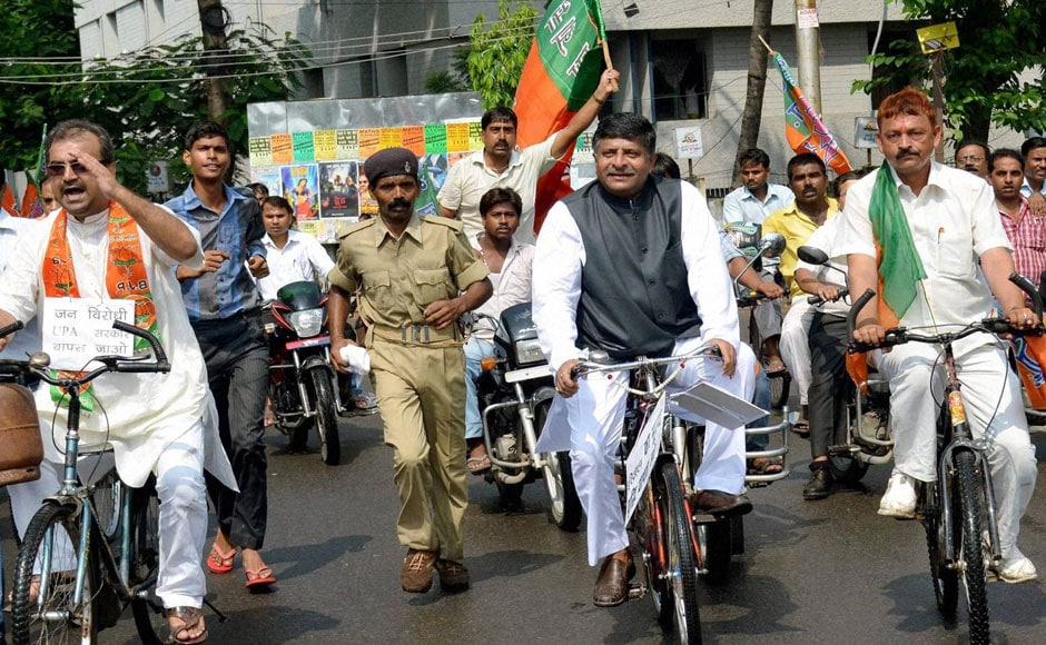 "BJP leader Ravi Shankar Prasad takes part in a bicycle rally during the ""Bharat bandh"" called to protest against FDI in retail and fuel price hike, in Patna. PTI"
