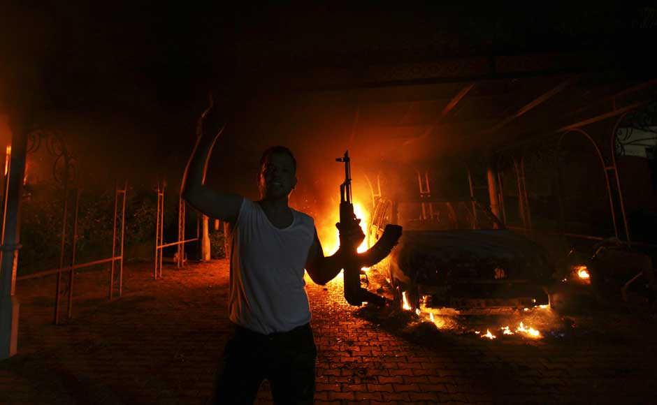 <br />A protester reacts as the US Consulate in Benghazi is seen in flames during a protest by an armed group said to have been protesting a film being produced in the United States on 11 September 2012. US Ambassador to Libya J Christopher Stevens and three other staff members perished in the rocket attack, Libyan security sources said on Wednesday. Esam Al-Fetori/Reuters