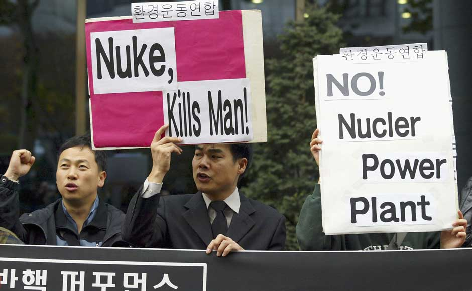<br />South Korean environmental activists protest during a anti-nuclear rally in front of the French cultural center on 10 November 2004 in Seoul, South Korea. Chung Sung-Jun/Getty Images