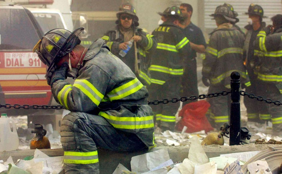 <br />A firefighter breaks down after the World Trade Center buildings collapsed on 11 September 2001 after two hijacked airplanes slammed into the twin towers in a terrorist attack. Mario Tama/Getty Images