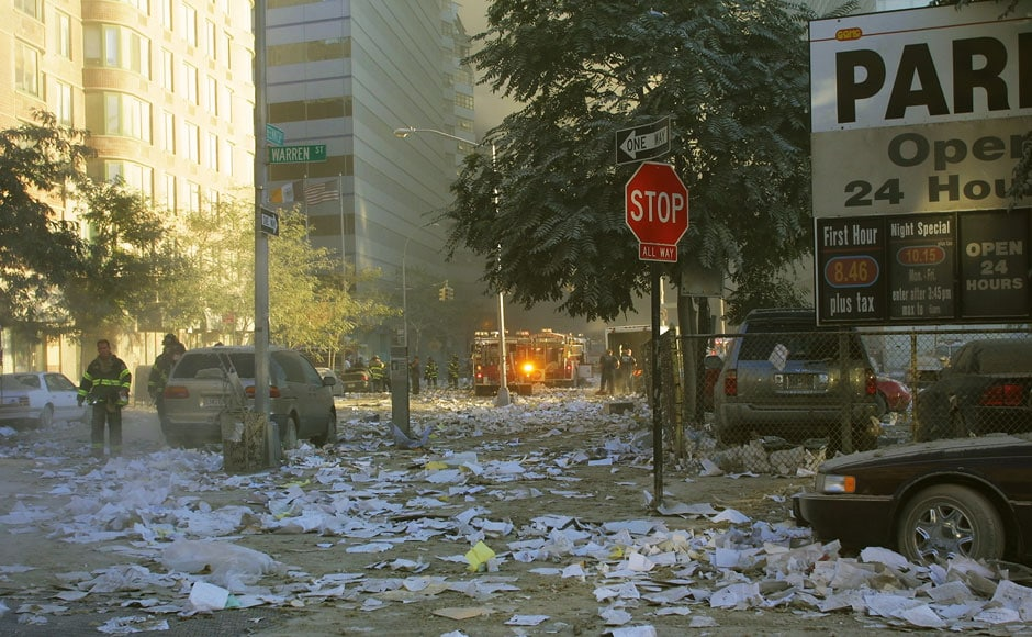 <br />Debris covers the streets around at the World Trade Center after two hijacked planes crashed into the Twin Towers on 11 September 2001 in New York. Ron Agam/Getty Images