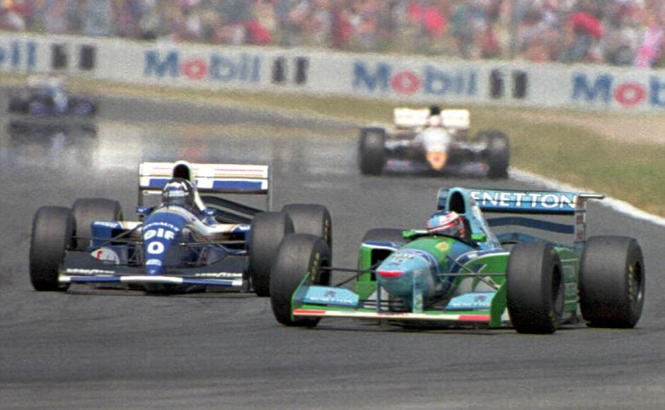 A whole season of controversies wasn't enough for Schumi before he won his first world title. Here he is, jostling with Damon Hill in the final race of the 1994 season. Both men retired from the race and the German kept his one-point lead. Getty Images